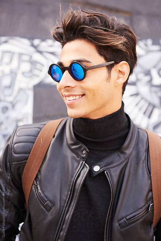 Close-up of trendy man in mirrored sunglasses by Guille Faingold for Stocksy United