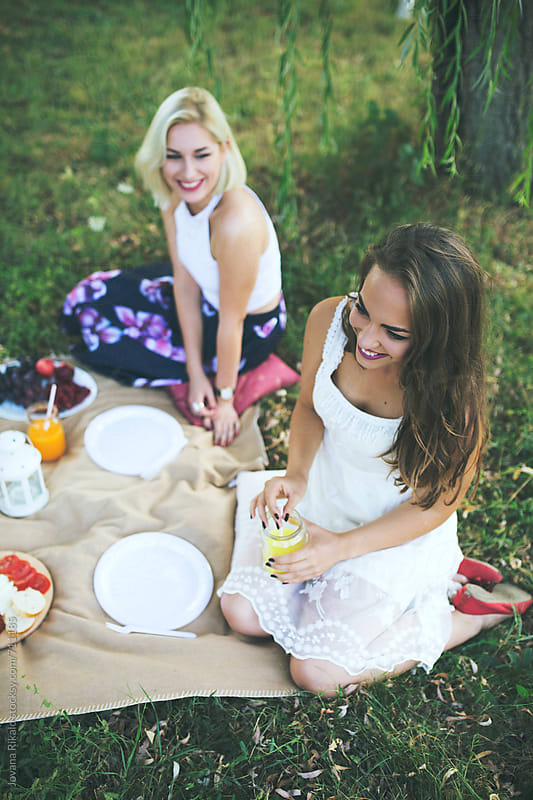 Female Friends Having Picnic by Jovana Rikalo for Stocksy United