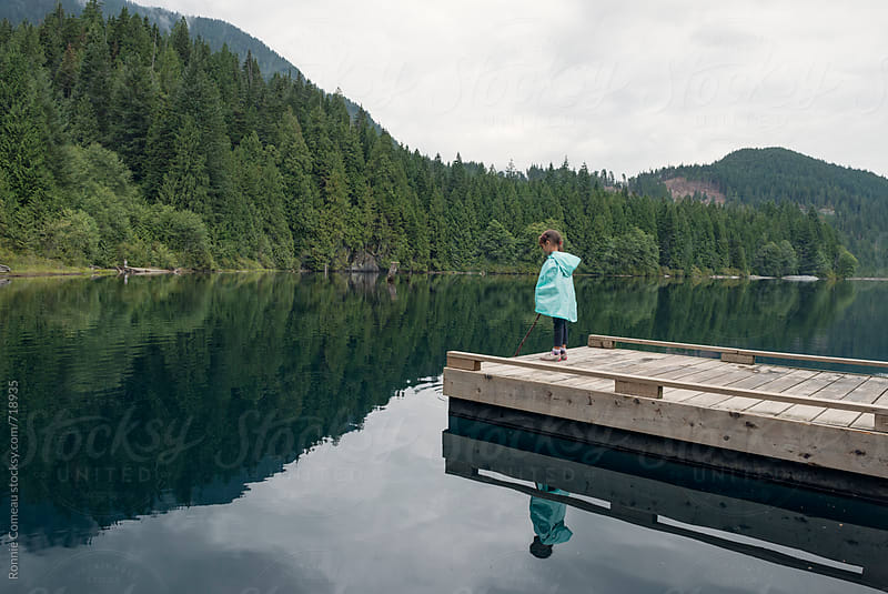 Young Girl Standing On Dock by Ronnie Comeau for Stocksy United