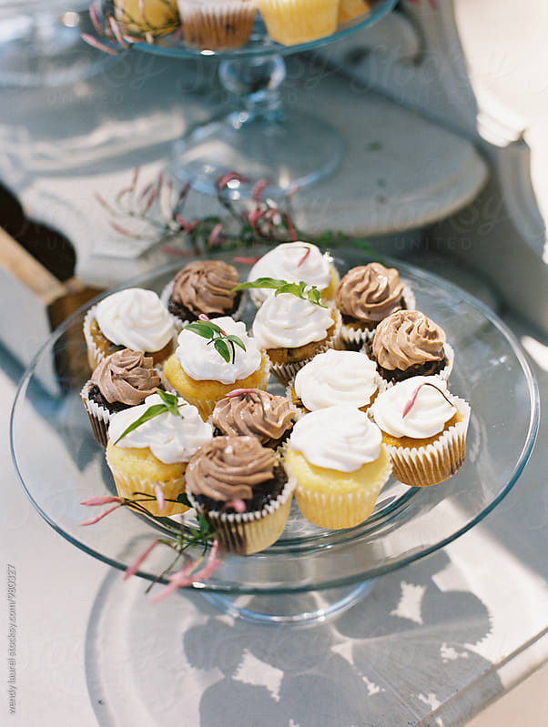 cupcakes on a glass plate by wendy laurel for Stocksy United