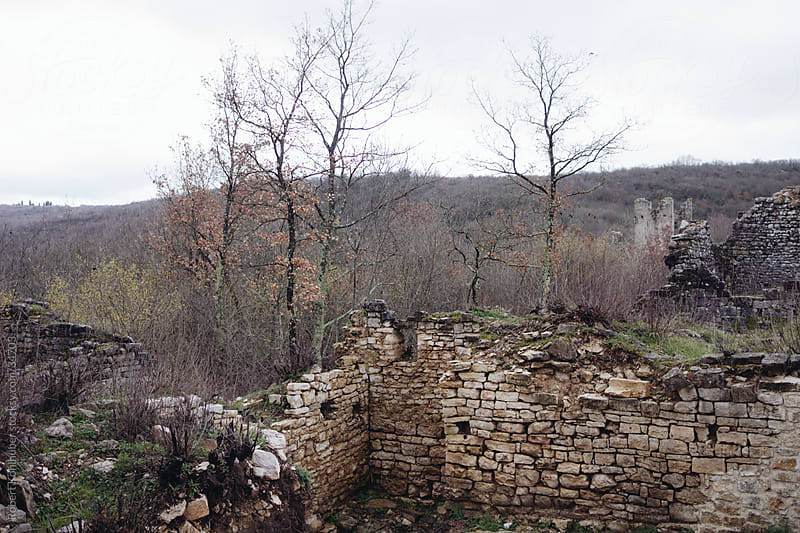 Old ruins of village by Robert Kohlhuber for Stocksy United