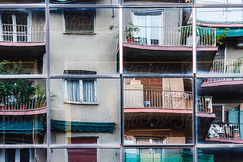 Apartment Building Reflected on Office Building by Helen Sotiriadis for Stocksy United
