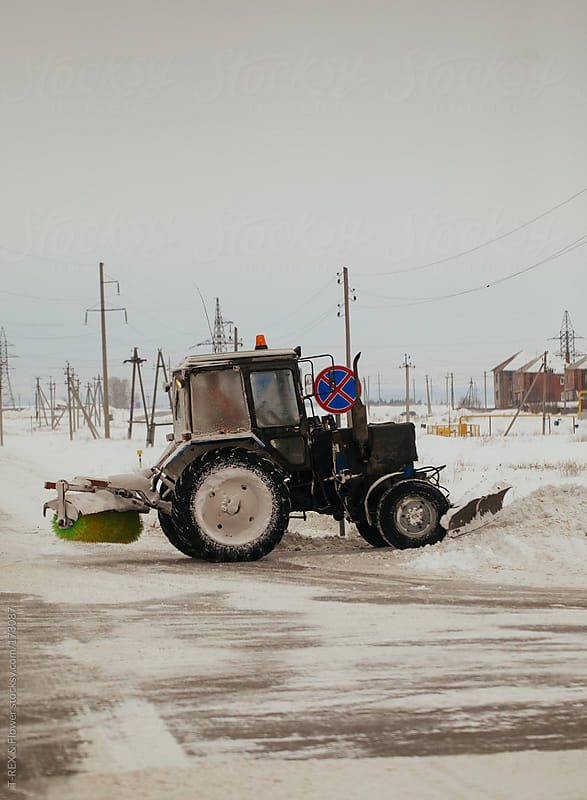 Tractor removes snow by T-REX & Flower for Stocksy United