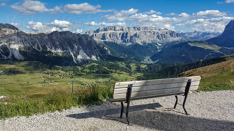 Bench overlooking Italian Dolomites by Andreas Wonisch for Stocksy United