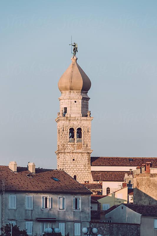 clocktower of krk by Leander Nardin for Stocksy United