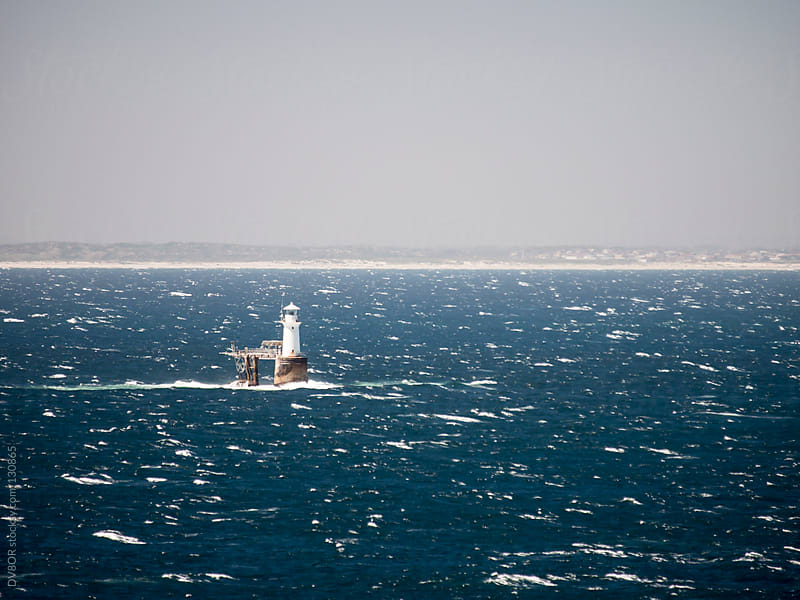 Lighthouse on windy seas with waves by DV8OR for Stocksy United