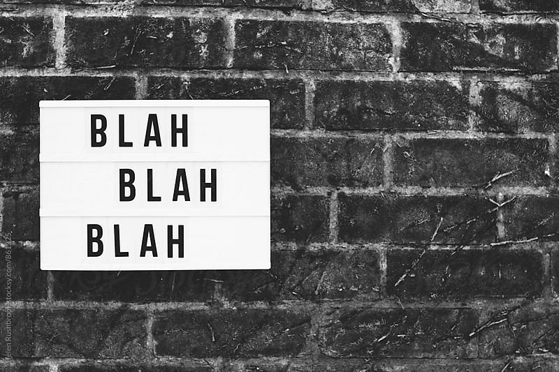 The words blah blah blah spelled out on a cinematic lightbox. by Helen Rushbrook for Stocksy United