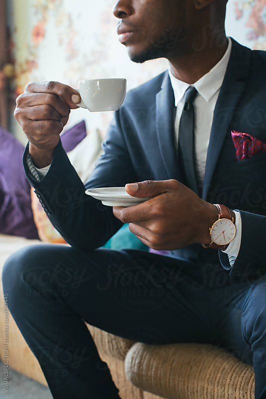 Close Up of Elegant Black Man Sitting in Stylish Living Room and Drinking Espresso by VISUALSPECTRUM for Stocksy United