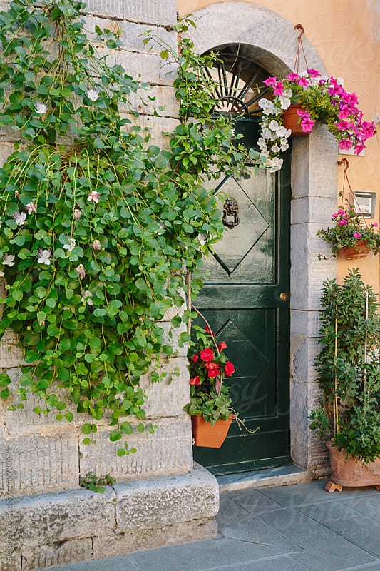 Green door in Tuscany by Simonfocus for Stocksy United