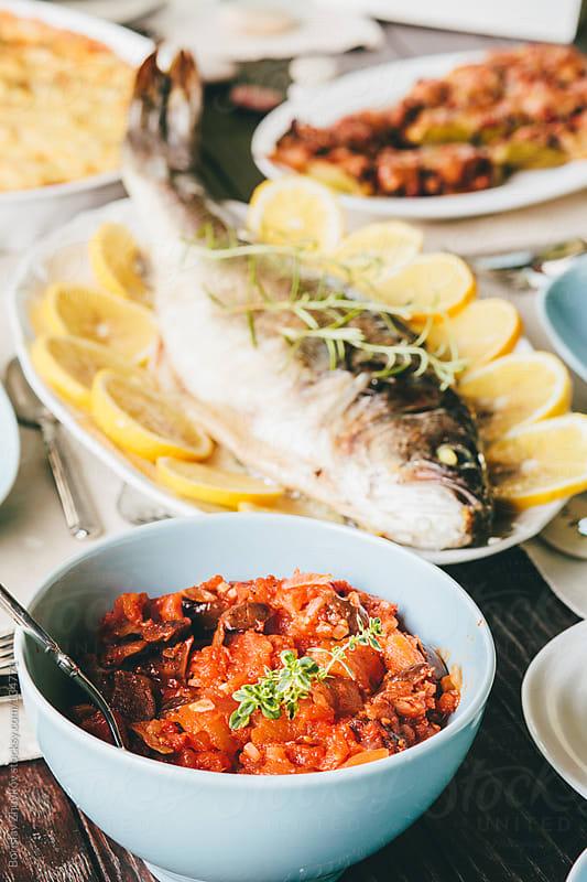 Sea bass and sauce  by Borislav Zhuykov for Stocksy United