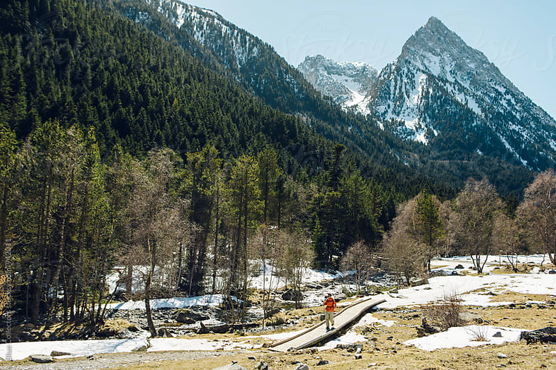 Mountaineer hiking in the snowy National Park by Jordi Rulló for Stocksy United