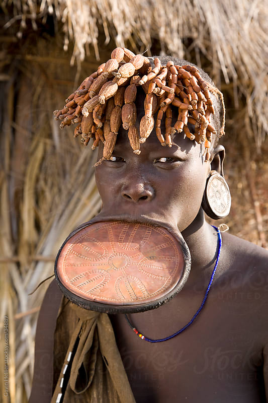 Mursi woman with clay lip plate, Mursi Hills, Mago National Park, Lower Omo Valley, Ethiopia, Africa.  by Gavin Hellier for Stocksy United