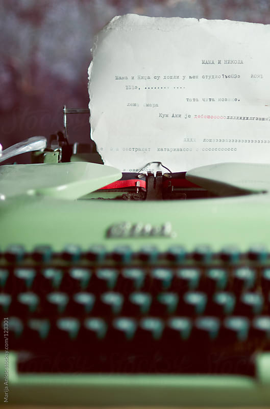 Paper in vintage retro typewriter by Marija Anicic for Stocksy United