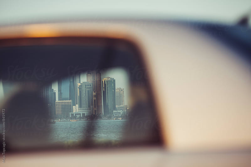 City through a moving car by Maja Topcagic for Stocksy United