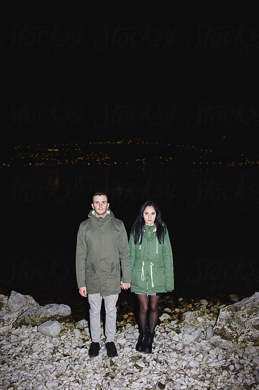 Portrait of teenager couple with hand in hand by michela ravasio for Stocksy United