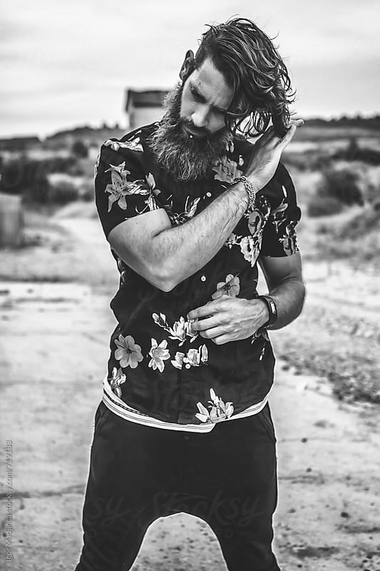 black and white, young hipster man dressed in black  by Igor Madjinca for Stocksy United