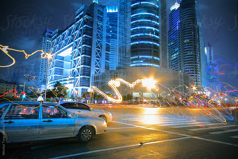Troubled car lights at night in Shanghai by Wenhai Tang for Stocksy United