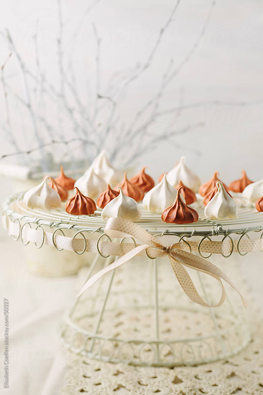 Meringues on a cake stand by Elisabeth Coelfen for Stocksy United
