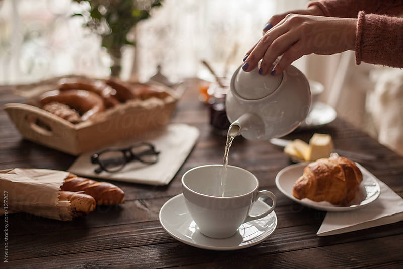 Female Hand Pouring Tea for Breakfast by Mosuno for Stocksy United