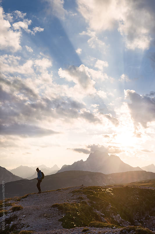 Female hiker walking at sunset in Dolomites by RG&B Images for Stocksy United