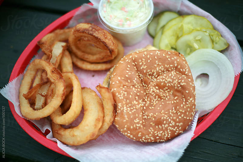 A Roadside Hamburger Lunch With Onion Rings by ALICIA BOCK for Stocksy United