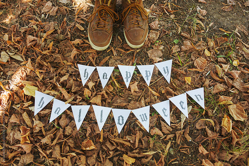 Happy Halloween letters made out of paper on leaves by Jovana Rikalo for Stocksy United
