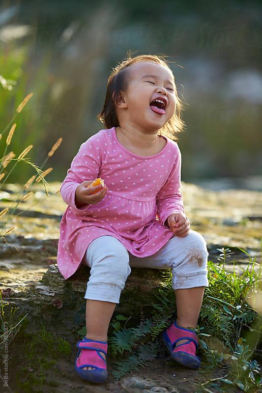lovely little asian girl outdoor  by Bo Bo for Stocksy United