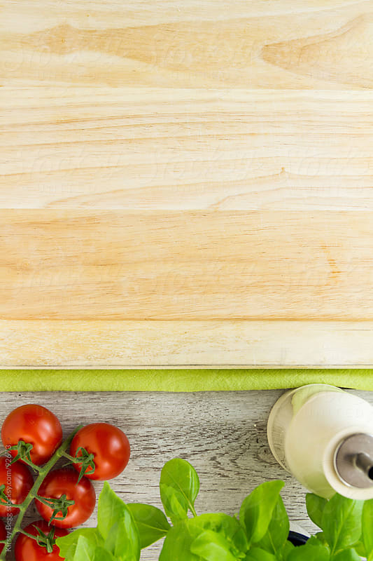 Chopping board with italian ingredients by Kirsty Begg for Stocksy United