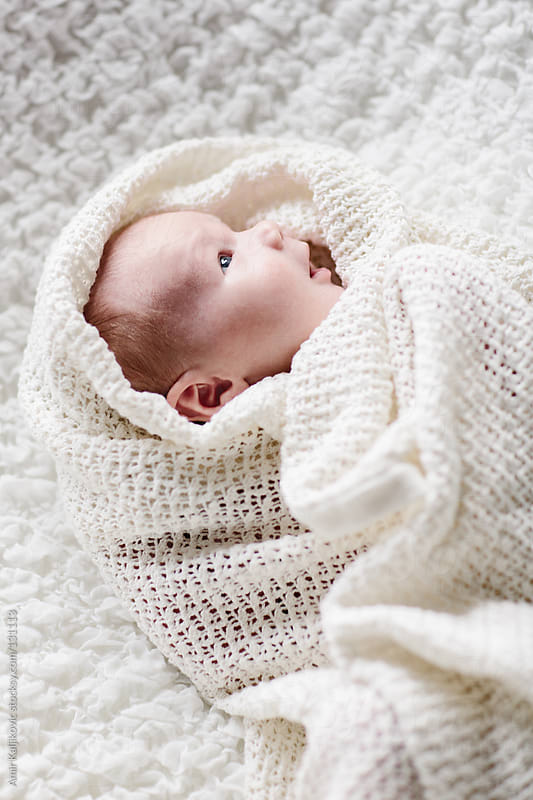 Adorable alert newborn baby by Amir Kaljikovic for Stocksy United