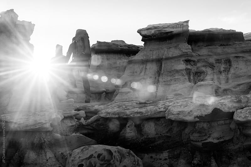 Backpacker Hiking in Bisti De Na Zin Wilderness Area New Mexico Badlands at Sunrise Black and White by JP Danko for Stocksy United