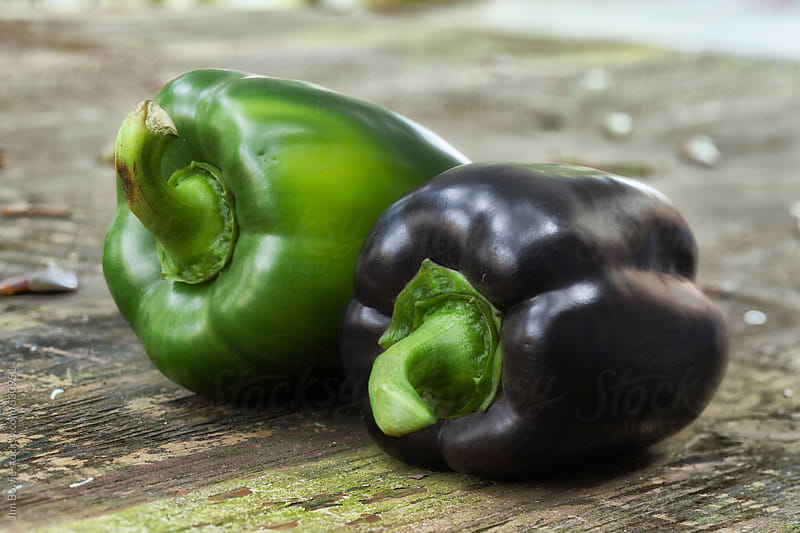 Green and purple bell peppers by JIm Bowie for Stocksy United