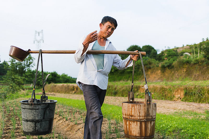 farmer working in the field by zheng long for Stocksy United
