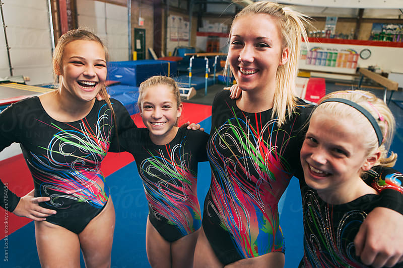 Gymnastics: Laughing Team Of Female Gymnasts by Sean Locke for Stocksy United