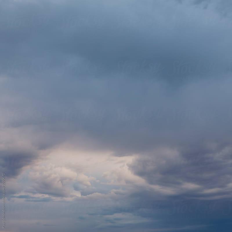 Dark and stormy sky at dawn, Utah by Paul Edmondson for Stocksy United
