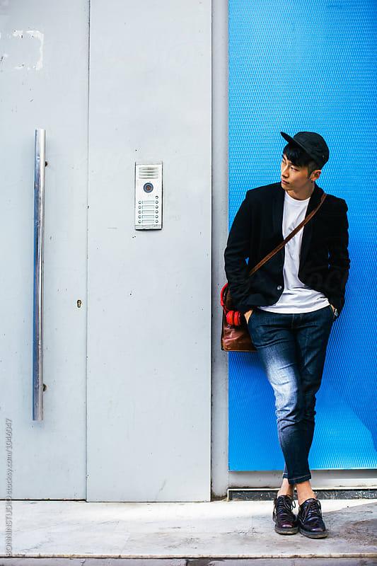 Stylish asian businessman waiting on the street.  by BONNINSTUDIO for Stocksy United