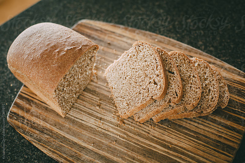 Brown Bread on Cutting Board by Kristopher Orr for Stocksy United