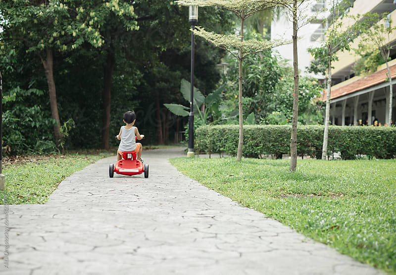 Young kid on his bike by Alita Ong for Stocksy United