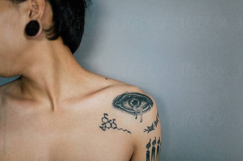Crying tattoo on the man shoulder by Nabi Tang for Stocksy United