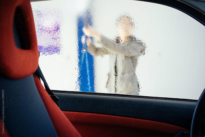 Girl washing car by Tommaso Tuzj for Stocksy United