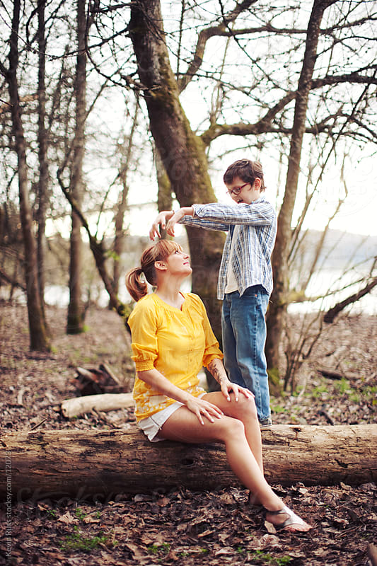 Small Family Playing by Kevin Russ for Stocksy United