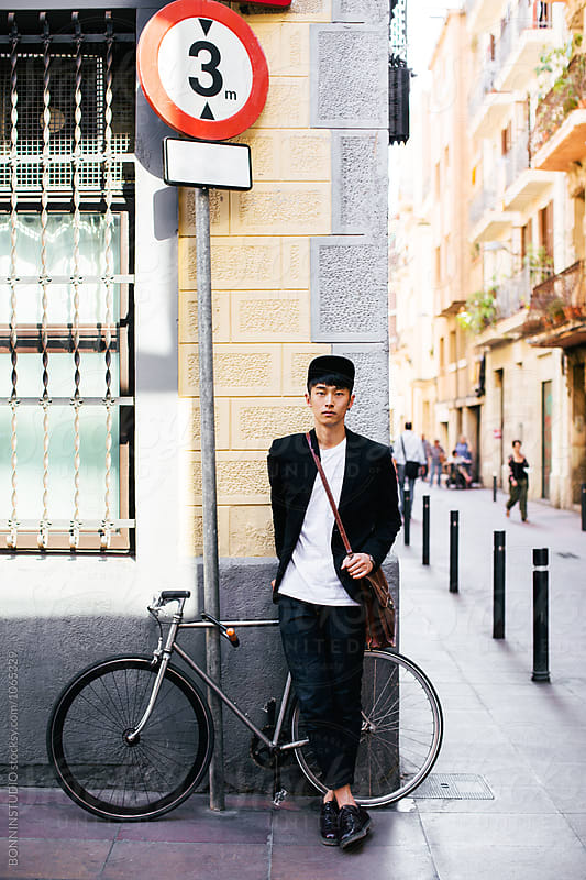 Casual businessman standing with bicycle on the street.  by BONNINSTUDIO for Stocksy United