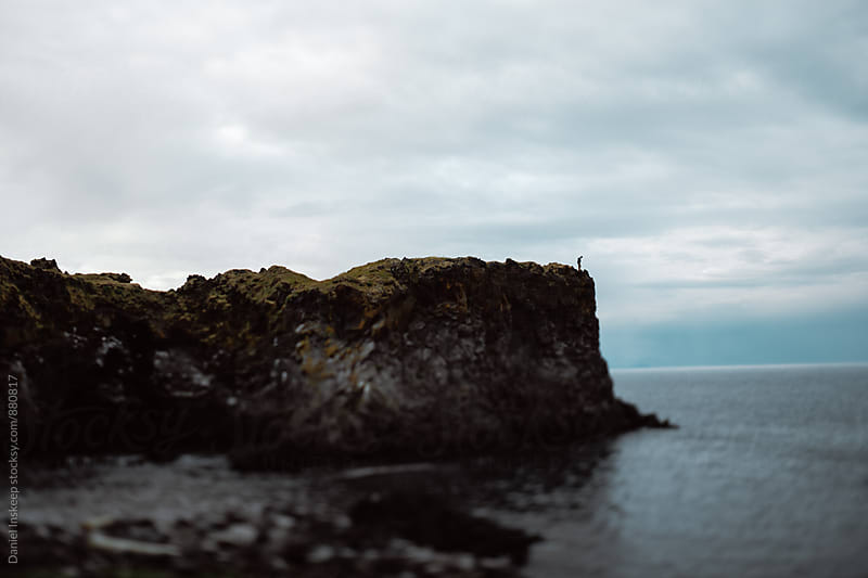 Silhouette on the Edge of a Cliff Overlooking the Atlantic by Daniel Inskeep for Stocksy United