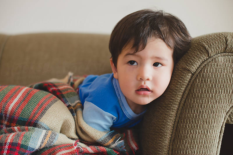 Toddler boy watching television by Lauren Naefe for Stocksy United