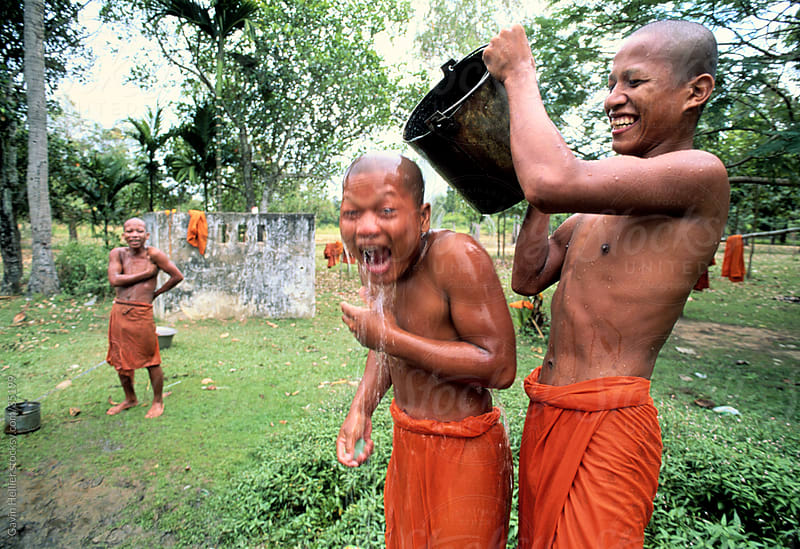 Novice Monks washing outside a Temple complex in Angkor Wat, Siem Reap, Cambodia, South-East Asia by Gavin Hellier for Stocksy United