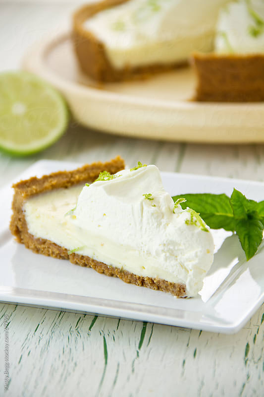 Key Lime Pie wedge with garnish by Kirsty Begg for Stocksy United