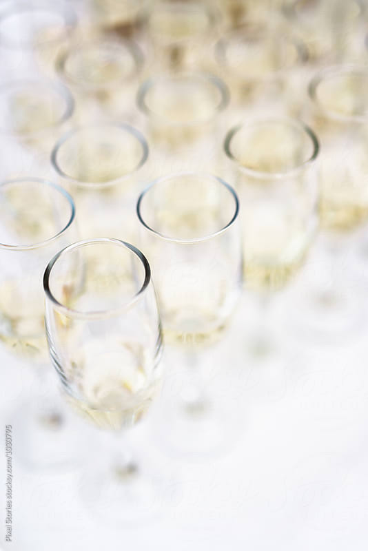 Wedding reception champagne glasses by Pixel Stories for Stocksy United
