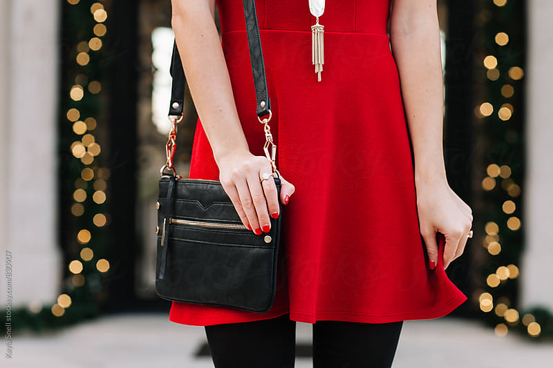 Woman in a red dress  by Kayla Snell for Stocksy United