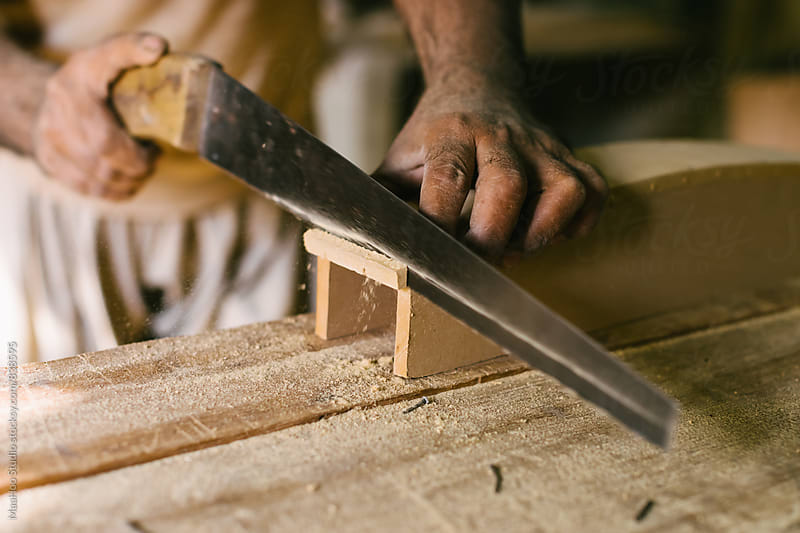 Carpenter sawing wood by Maa Hoo for Stocksy United