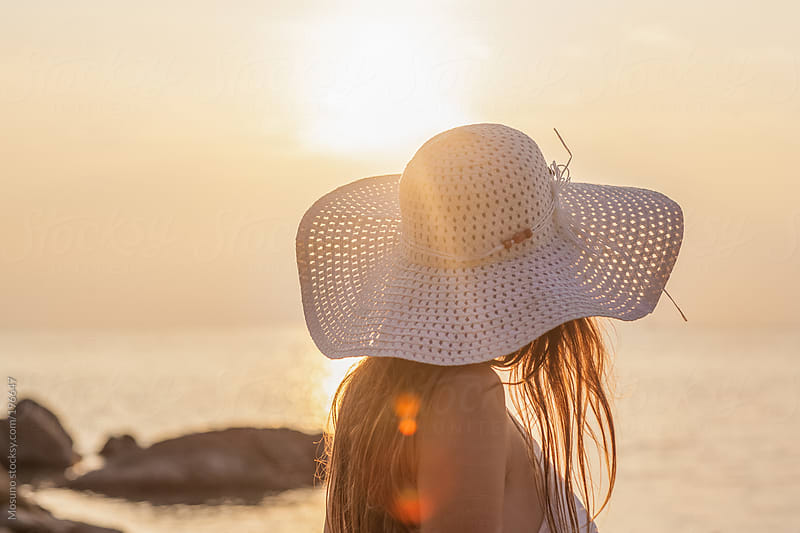 Woman Wearing White Hat at the Beach by Mosuno for Stocksy United