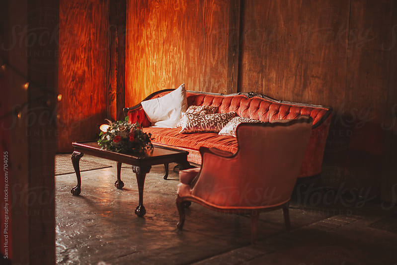 warm interior photos of red couch by Sam Hurd Photography for Stocksy United
